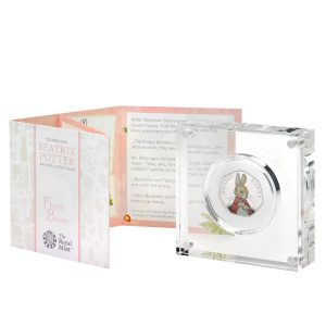 Image of the Flopsy Bunny 50p silver proof coin in its acrylic case and accompanying booklet