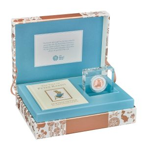 Image of gift set containing gold Peter Rabbit 2018 UK 50p coin and book