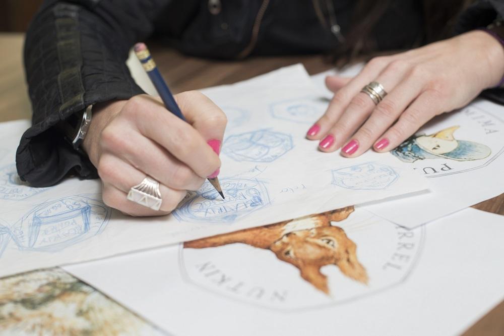 Close up of Emma Noble designing the Beatrix Potter 50p coins